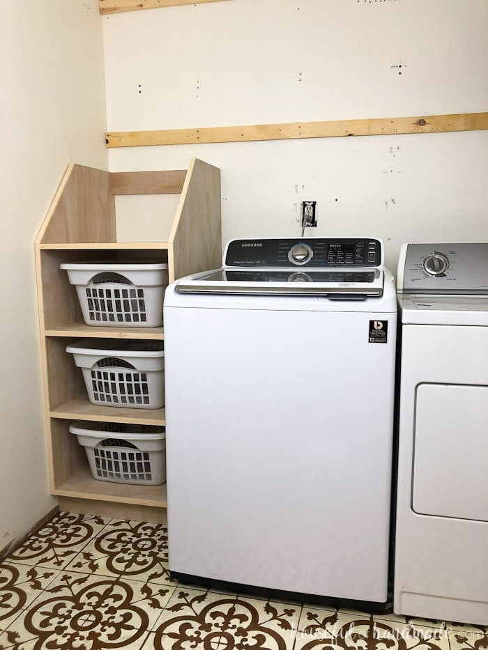 Stackable laundry basket storage shown in laundry room.