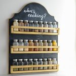 Wall spice organizer with chalkboard back and 3 rows for lots of spice storage.
