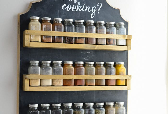 Free up your counters and cabinets with this beautiful wooden spice rack. It's the perfect farmhouse kitchen decor and so easy to make. Housefulofhandmade.com
