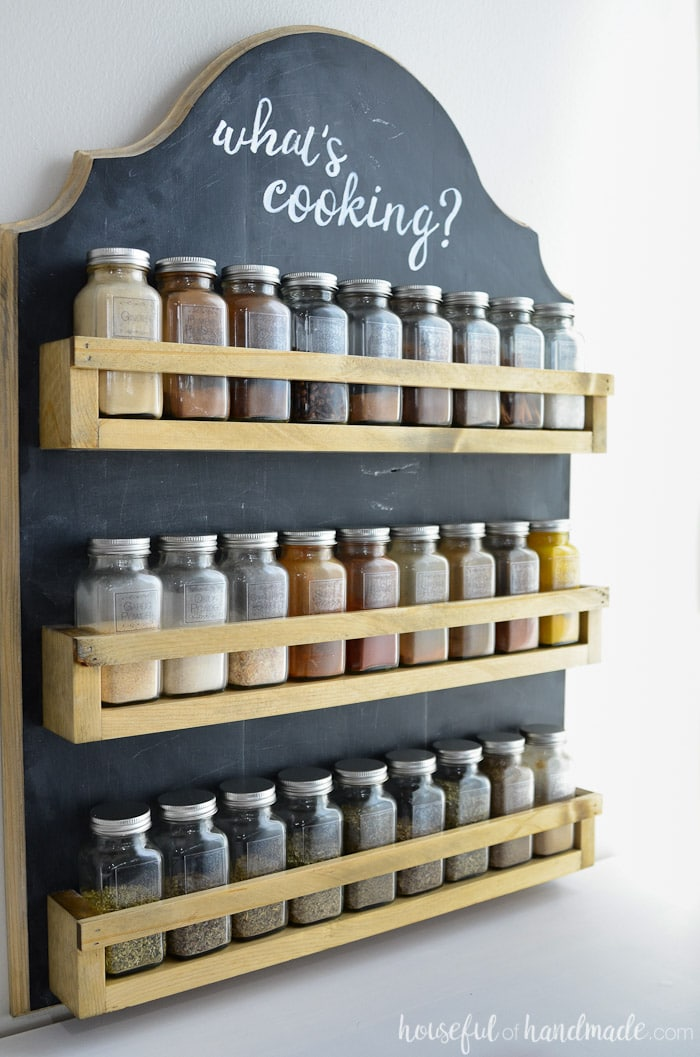 I love this hanging spice rack! It is the perfect way to organize your spices in the kitchen. Get the plans for the easy to build wooden spice rack at Housefulofhandmade.com.