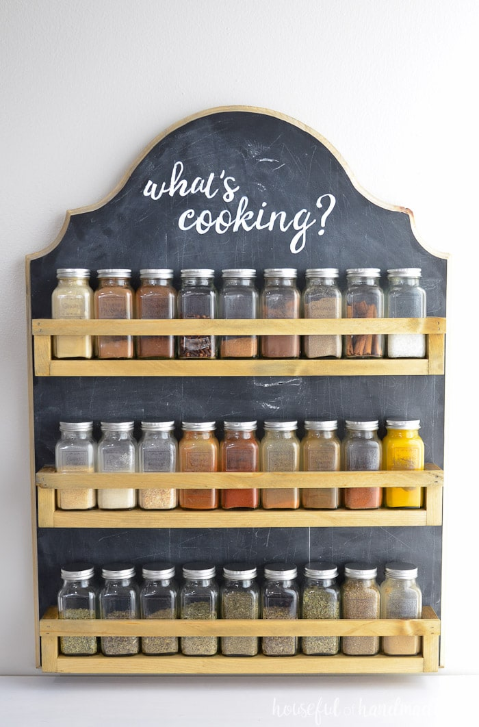 This beautiful farmhouse spice rack was made for less than $10. It's the perfect spice organizer and frees up space in your kitchen. Get the build plans for the DIY spice rack at Housefulofhandmade.com.