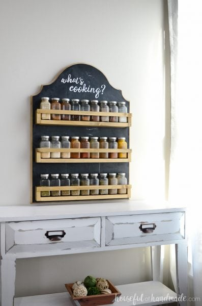 This wooden spice rack is the perfect way to organize all your spices. The hanging spice rack keeps the spices at your finger tips while you cook and acts as art in your kitchen. You are going to love how easy this DIY spice rack is to build with these free build plans. Housefulofhandmade.com