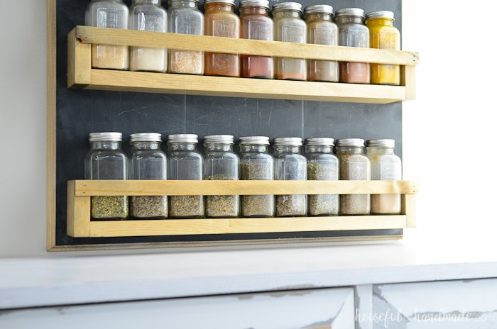 This large spice rack holds all our spices and looks so beautiful on the wall in the kitchen. Build a wall mounted spice rack for just a few dollars . Housefulofhandmade.com