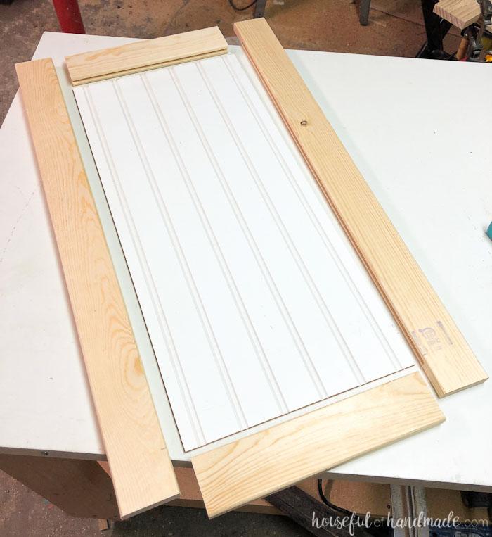 Cabinet door rails and stiles around a piece of beadboard. Housefulofhandmade.com