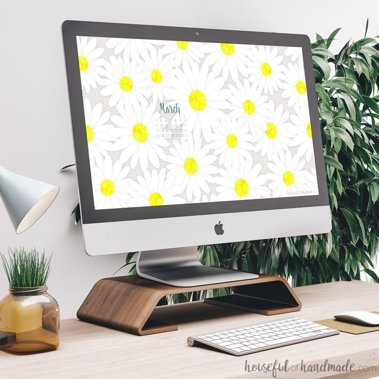 A computer screen with the beautiful free digital backgrounds for March on the screen. Housefulofhandmade.com