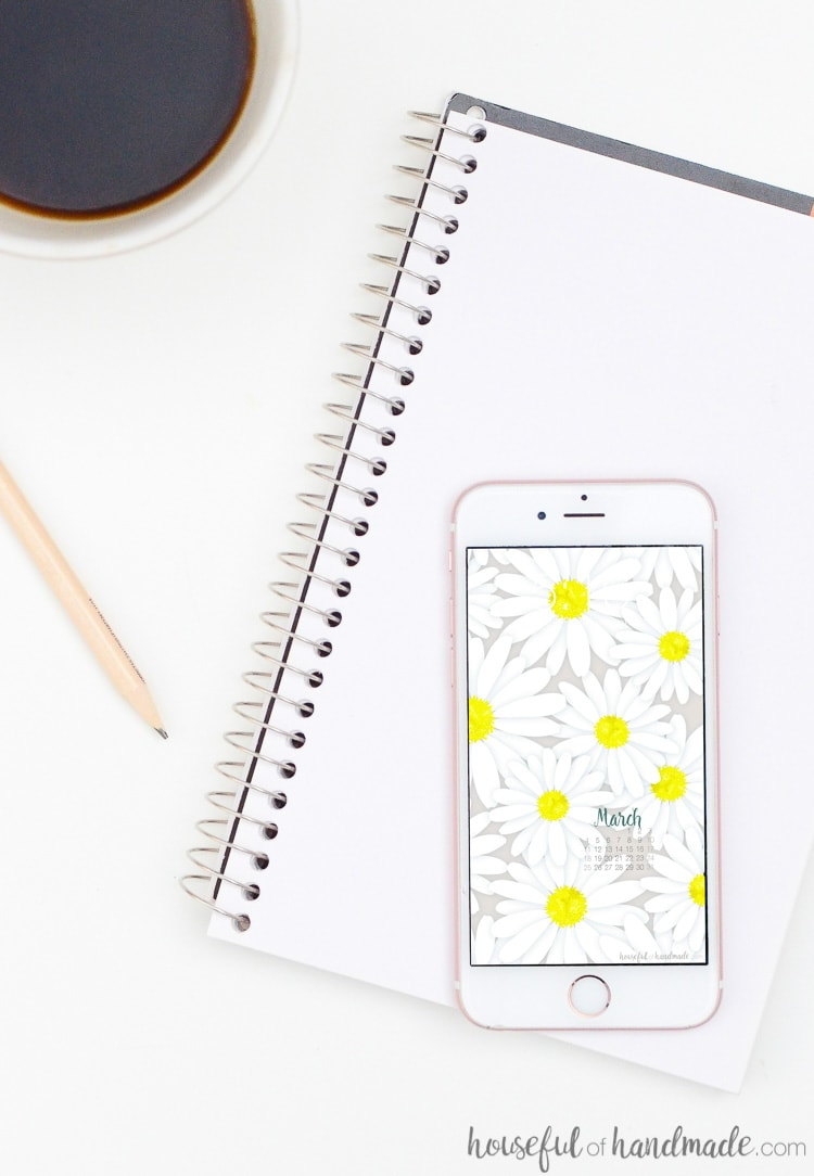 Daisy floral print on a white iPhone on a sketchpad. Download the free digital backgrounds for March at Housefulofhandmade.com.