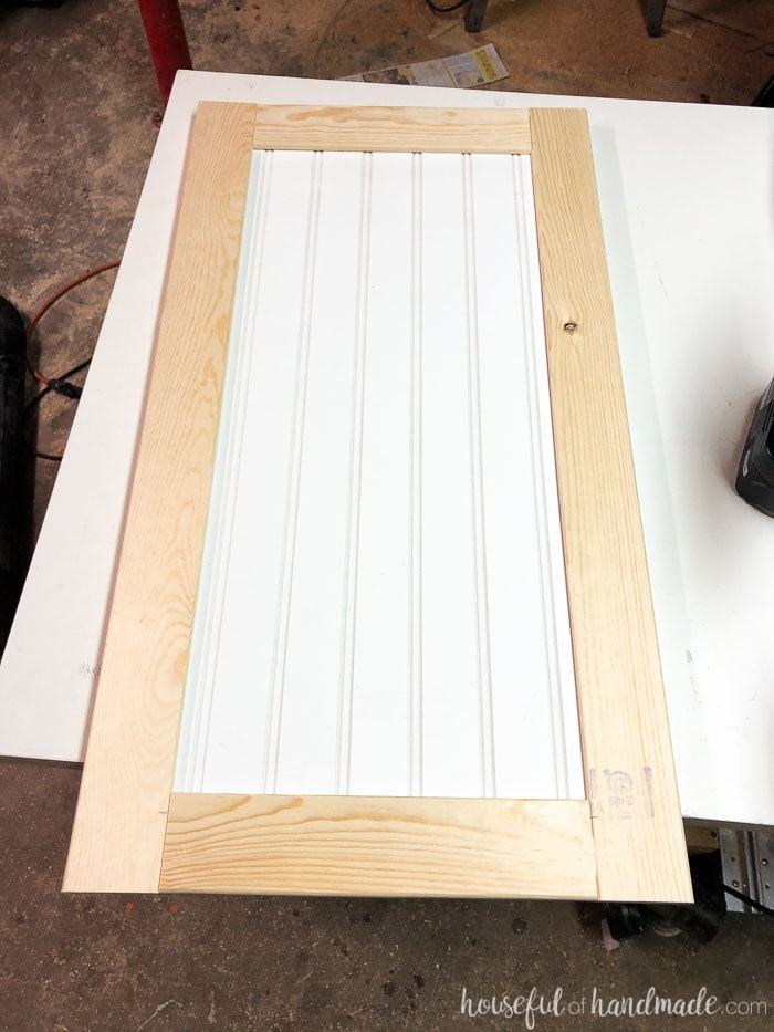 Unfinished shaker style cabinet door with beadboard panel. Build cabinet doors cheap. Housefulofhandmade.com
