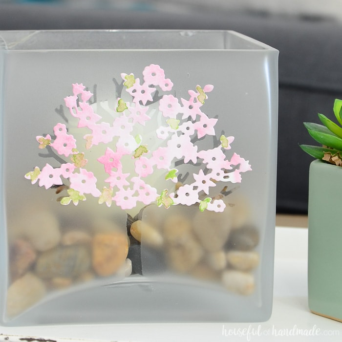 Square candle holder with frosted tree decorated with spring blossoms. Housefulofhandmade.com