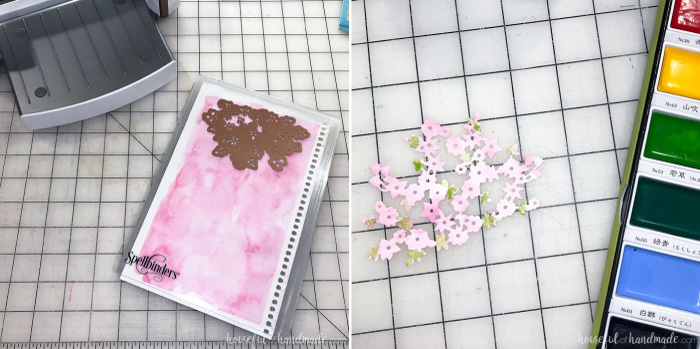 Watercolored paper being cut out with the Spring Canopy Spellbinders die for the large glass candle holder decor. Housefulofhandmade.com