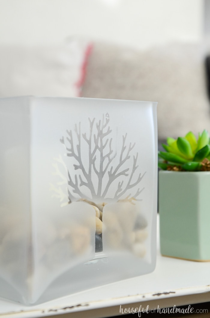 A tree design in a frosted glass candle holder. On a tray next to a succulent. Housefulofhandmade.com