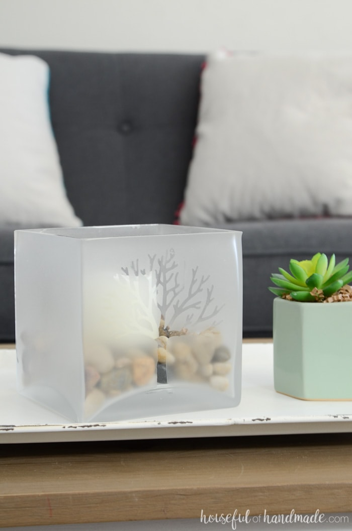 Frosted glass candle holder with tree design on a tray in front of a navy sofa. Easy DIY home decor. Housefulofhandmade.com