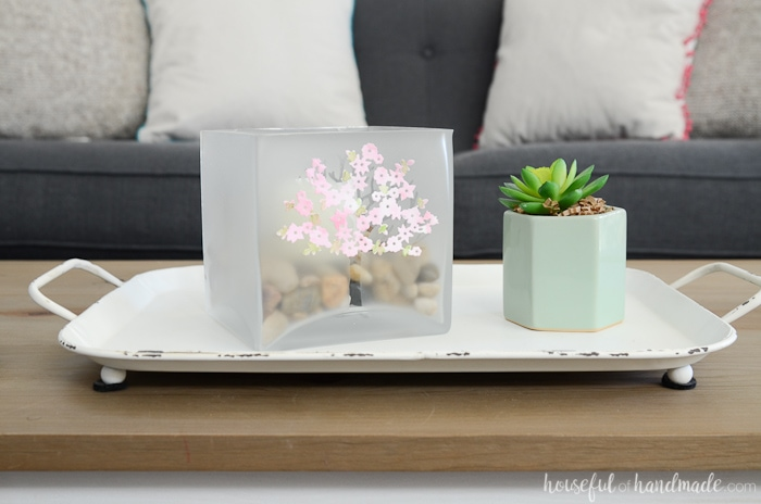 A square large glass candle holder for spring on a white tray next to a small planted succulent. Housefulofhandmade.com