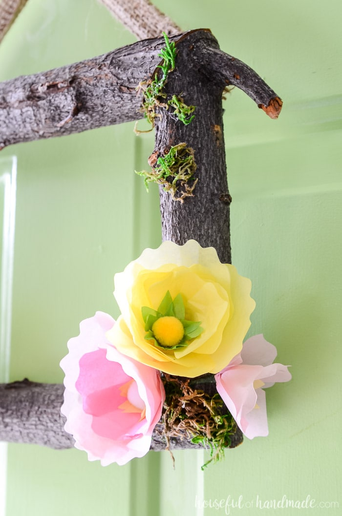 Beautiful tissue paper flowers on a log wreath form. The perfect spring flower wreath. Housefulofhandmade.com