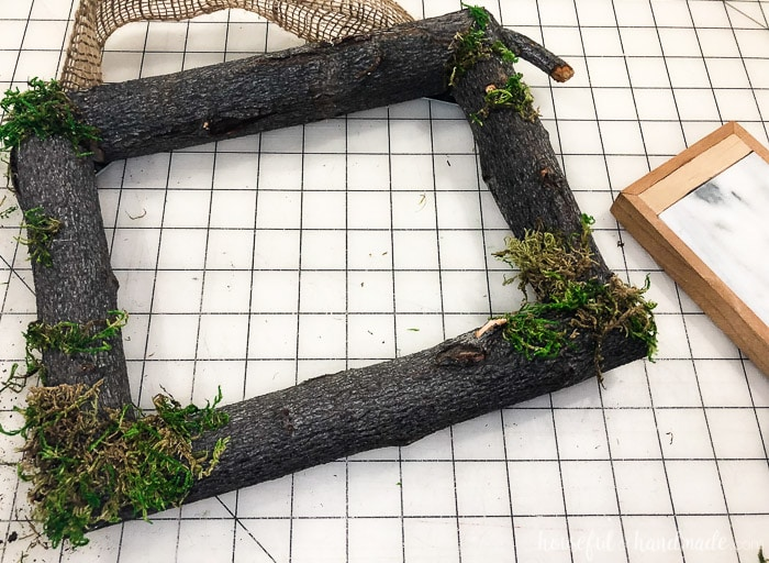 Glue moss to the frame in the corners and randomly around the logs of the spring wreath for front door. Housefulofhandmade.com