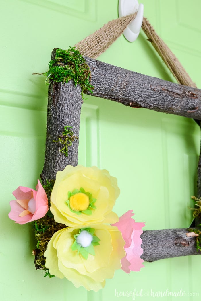 Spring flower wreaths are the perfect way to start decorating your home for spring. I love spring wreaths for the front door. Make this beautiful spring wreath with simple tissue paper flowers and branches. Housefulofhandmade.com