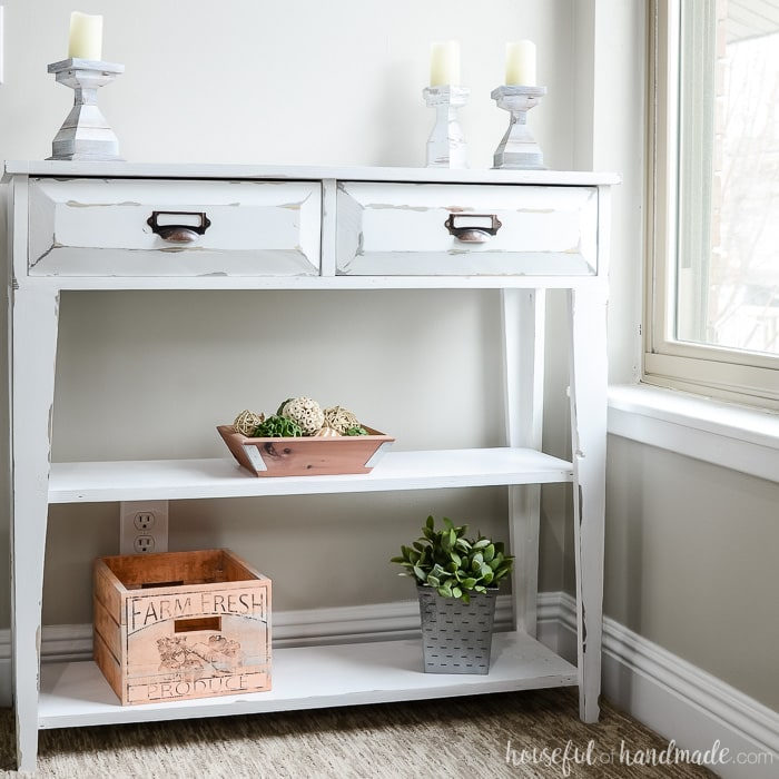 Build a beautiful small console table to add storage and decor to your home. This DIY farmhouse console table has two large drawers and two shelves. Housefulofhandmade.com