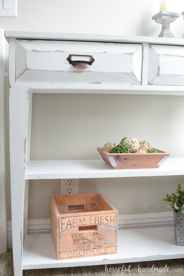 The tampered legs and open shelves give this small console table lots of farmhouse style. Housefulofhandmade.com