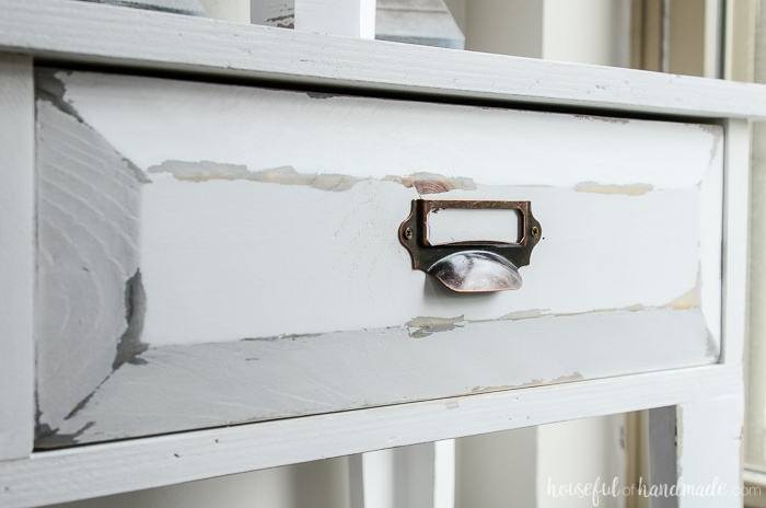 Closeup of the distressing on the farmhouse console table drawer fronts. Housefulofhandmade.com