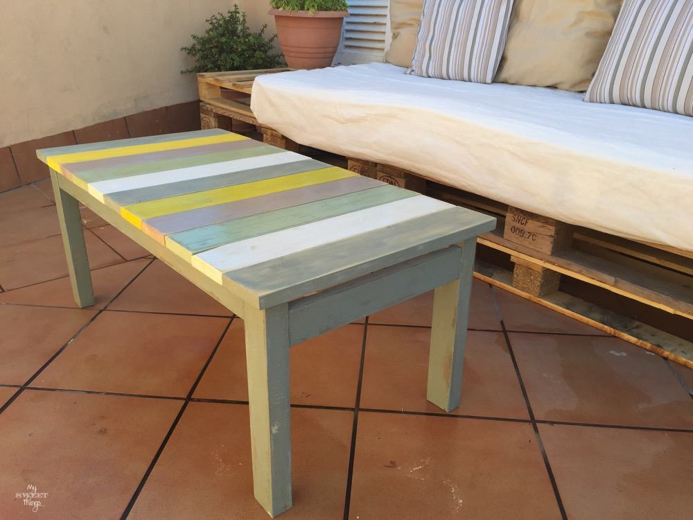 If you love color in your DIY patio furniture, then this Colorful Wood Slat Table fromSweet Things is perfect for you! She transformed an old damaged table ready for the trash into a beautiful new table.