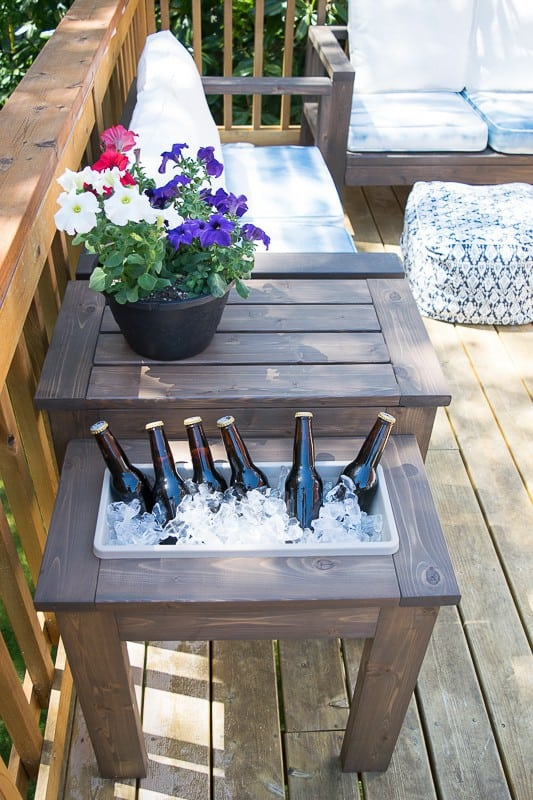 Why create a table that will just hold your drink when you can create a table that will keep it cold instead? I love thisDIY End Table with Built-in planter or Ice BucketbyThe Handyman's Daughter and I know my husband will too!