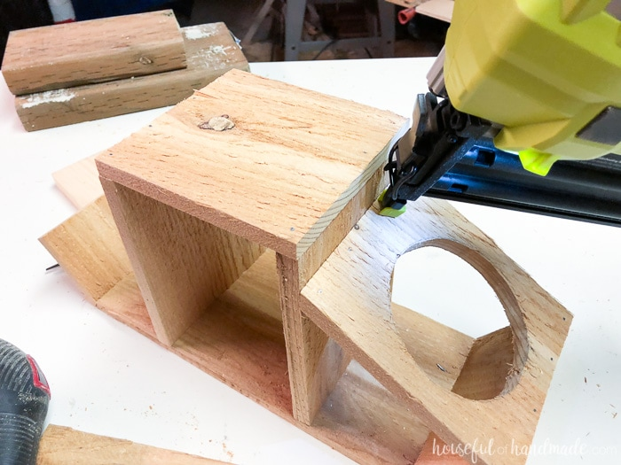 Attach the sides of the kitchen herb planter with the nail gun. Housefulofhandmade.com