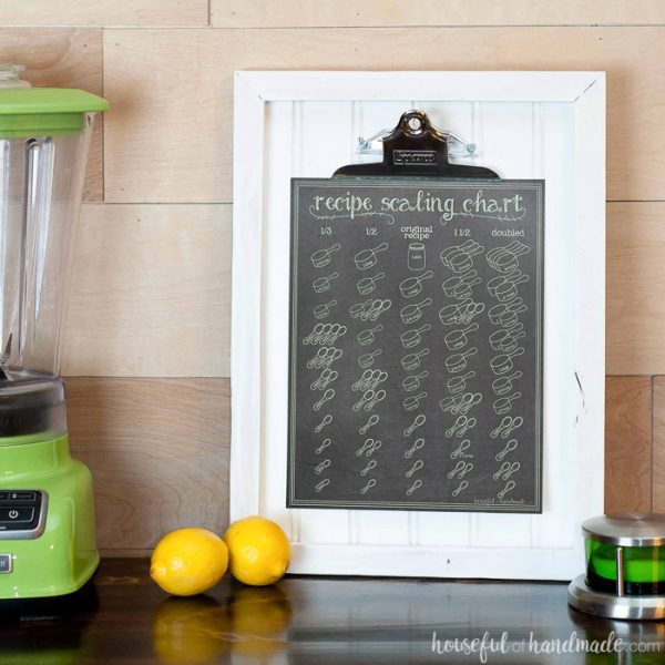 This printable recipe scaling chart is the perfect kitchen helper tool. Includes measurements to help you 1/3, half, 1 1/2 and double a recipe. Cute chalkboard printable on a white beadboard picture frame. Housefulofhandmade.com