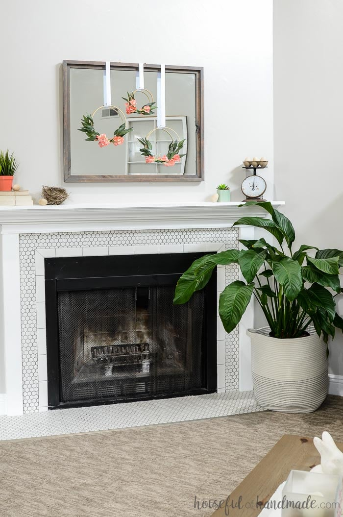 Get ready for warmer weather with this simple mantel decor for spring. Even if spring has not come to your town, you can bring a little spring inside with these easy decorating tips. This simple mantel decor for spring uses soft colors and florals to brighten up your decor. Housefulofhandmade.com