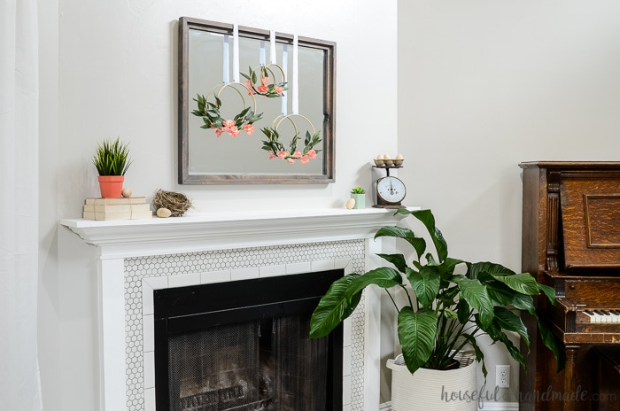 Simple spring decorations over the fireplace. Embroidery hoop wreaths and wooden eggs. Housefulofhandmade.com