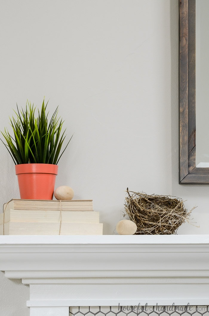 Use found items like nests in your mantel decor for spring. See all the spring decorating tips at Housefulofhandmade.com.