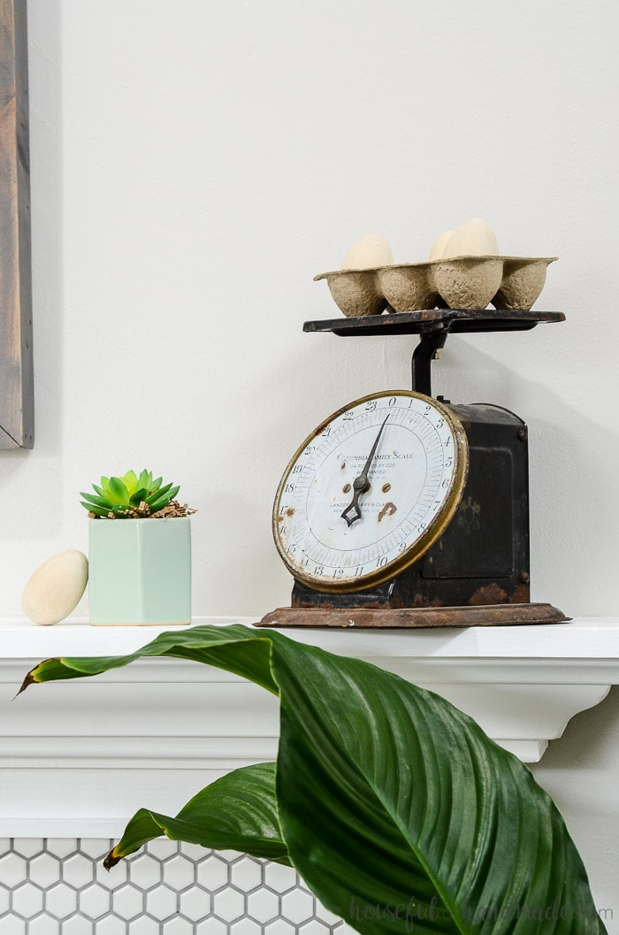 Turn a vintage scale into spring decor with inexpensive wooden eggs. The perfect mantel decor for spring. Housefulofhandmade.com