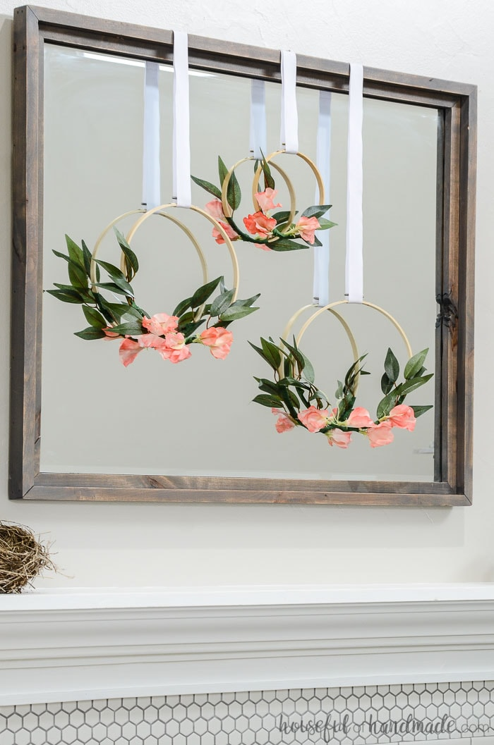 Coral flowers on an embroidery hoop wreath. Hung as part of our simple mantel decor for spring. Housefulofhandmade.com