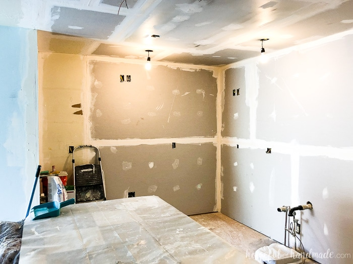 The walls and ceiling are covered in drywall now! We are on track for our 6 week DIY kitchen remodel. Follow along at Housefulofhandmade.com.