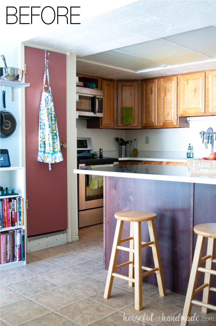 Say goodbye to narrow pantry closets and a drop ceiling in this budget farmhouse kitchen remodel. See the after at Housefulofhandmade.com.