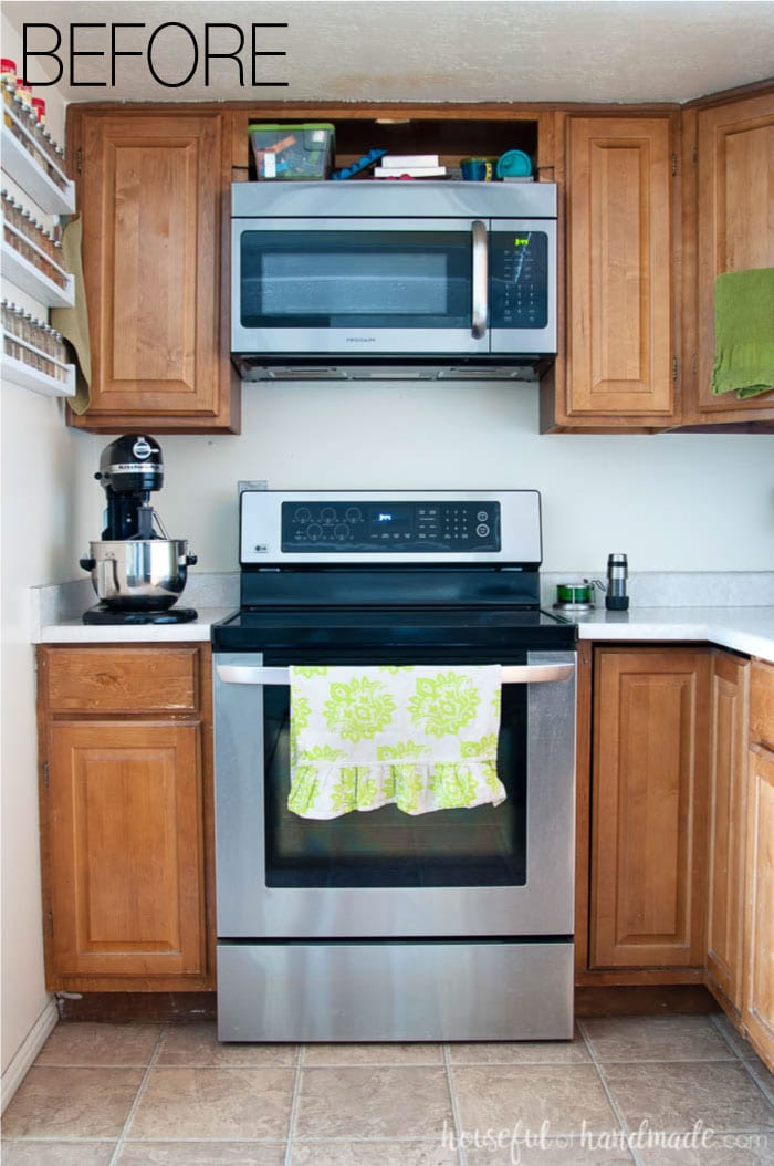 Stainless steel stove and above stove microwave are staying in this budget farmhouse kitchen remodel. See the rest of the plan at Housefulofhandmade.com.