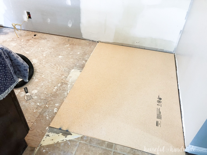 Adding new subfloor is necessary since we pulled out the old pantry. See the complete budget kitchen remodel at Housefulofhandmade.com.