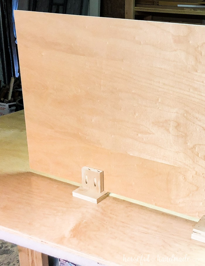 These easy to make helping hands give you and extra set of hands (or two) when working in the garage. Super helpful for larger projects like building your own cabinets. Housefulofhandmade.com
