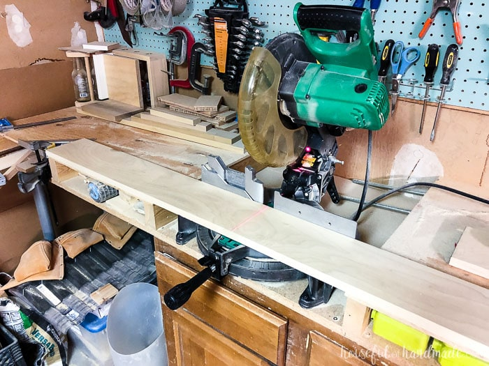 Miter saw tables do not have to be expensive or fancy. We used old kitchen cabinets ready for the trash and then built a top to be level with the miter saw bed with scraps and inexpensive wood. Housefulofhandmade.com