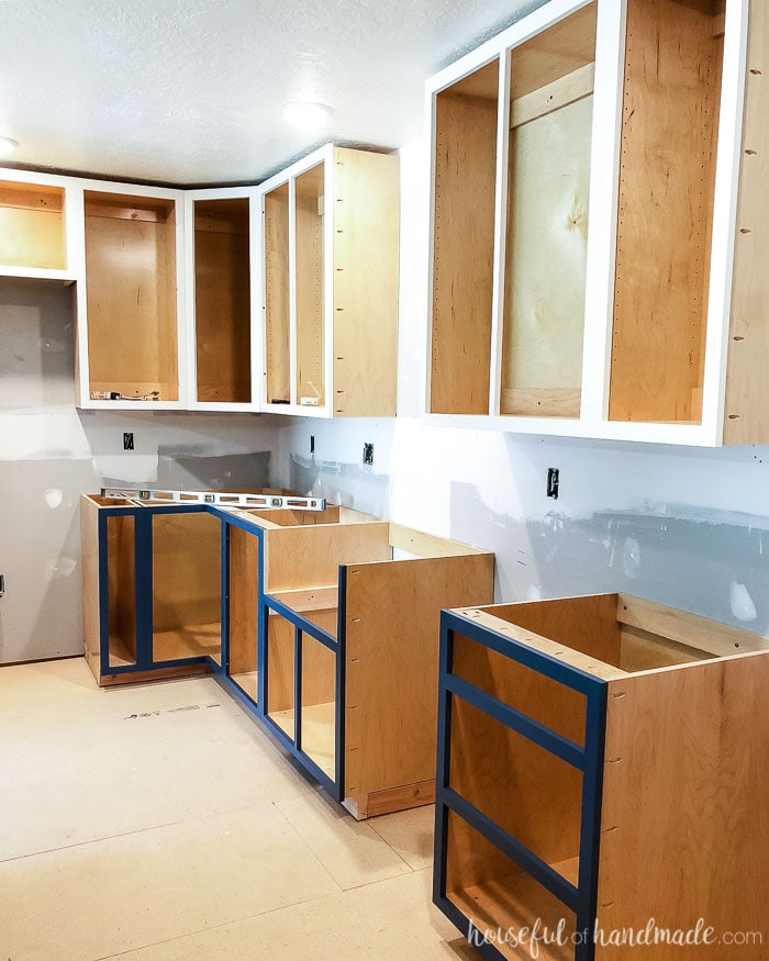 Installed cabinet boxes without doors in teh kitchen remodel. The DIY kitchen cabinets were installed on 2x4 base.
