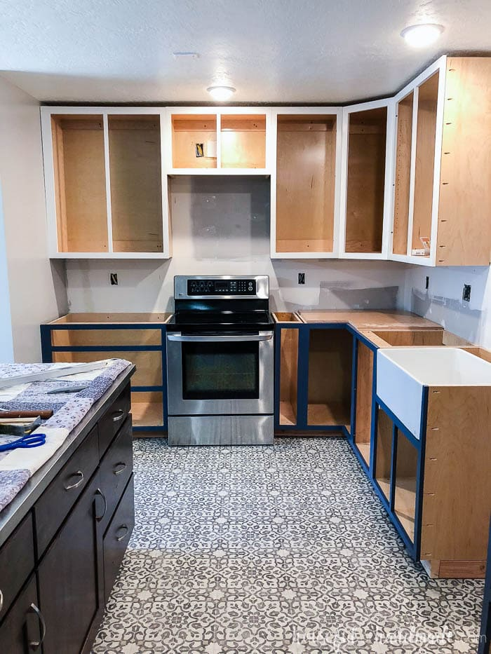 All the cabinet boxes are installed. I love the two-tone kitchen. See our tips for surviving a kitchen remodel at Housefulofhandmade.com.