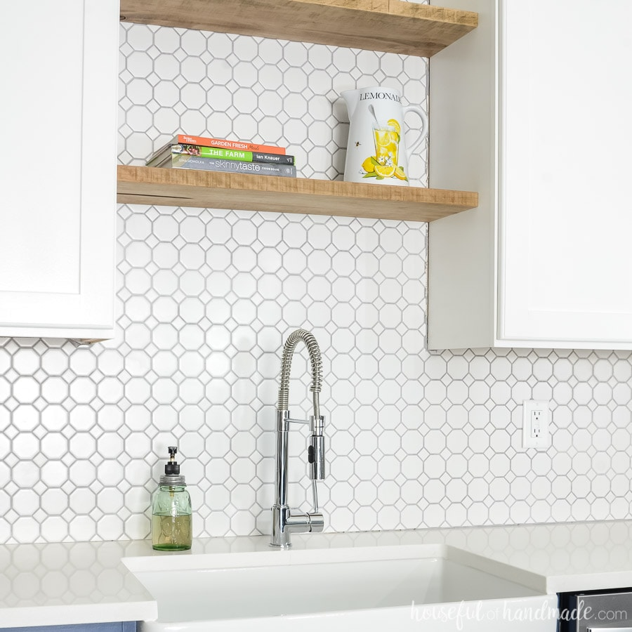 See how we transformed our dark outdated kitchen into a dream kitchen. Complete with stunning backsplash, open shelving and handmade cabinets. Housefulofhandmade.com