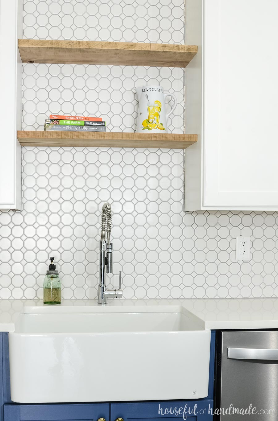Thick maple boards were turned into floating shelves above the kitchen sink. White octagon tile is the perfect backsplash to fill the space behind it. Housefulofhandmade.com