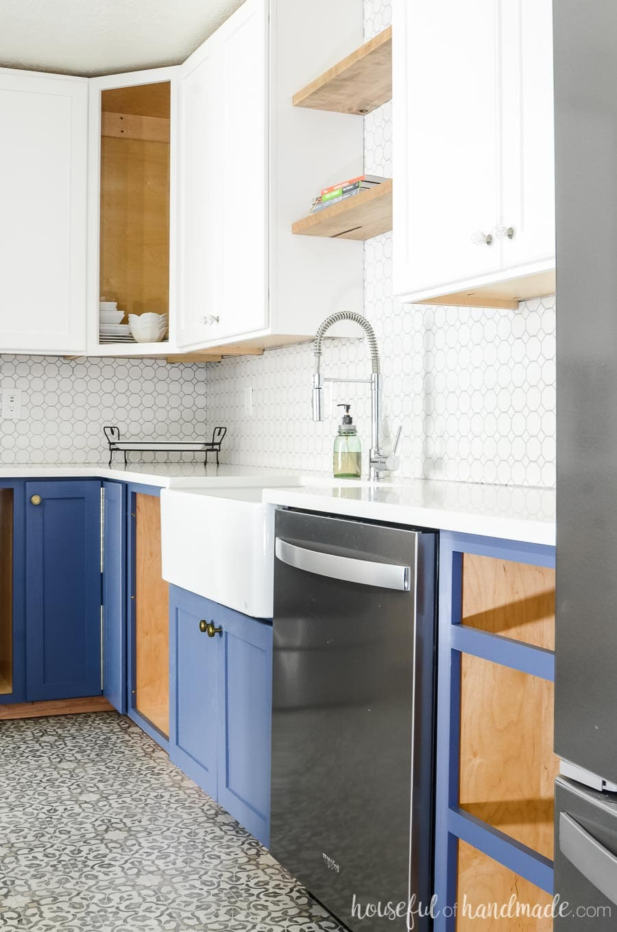 Farmhouse kitchen remodel with Durango Blue base cabinets and Polar Bear upper cabinets. White octagon tile and large farmhouse sink. Housefulofhandmade.com