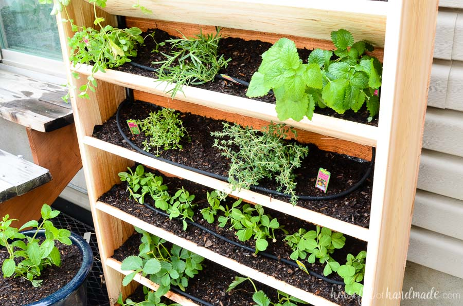 This vertical cedar garden was built in just an hour and makes the perfect small space garden idea. Includes a drip watering system to keep your plants healthy all season. Get the tutorial at Housefulofhandmade.com.