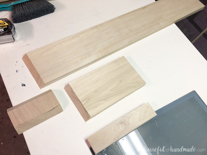 Pieces of hardwood to build the decorative base for the kitchen island makeover.