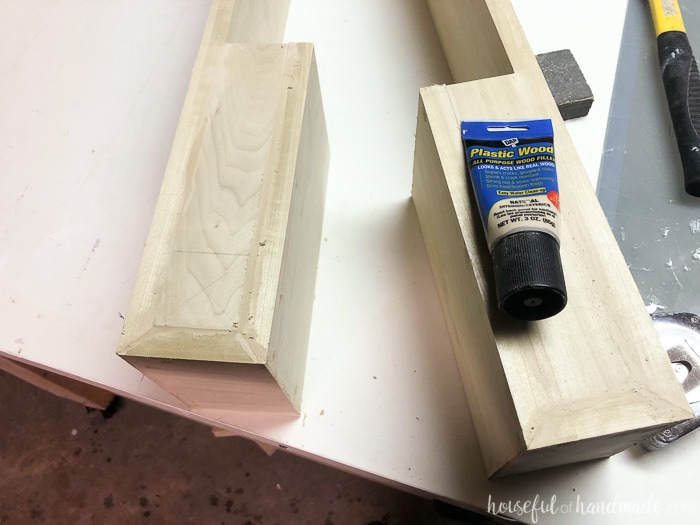Use wood filler to create a seamless surface on the new kitchen island makeover. Housefulofhandmade.com