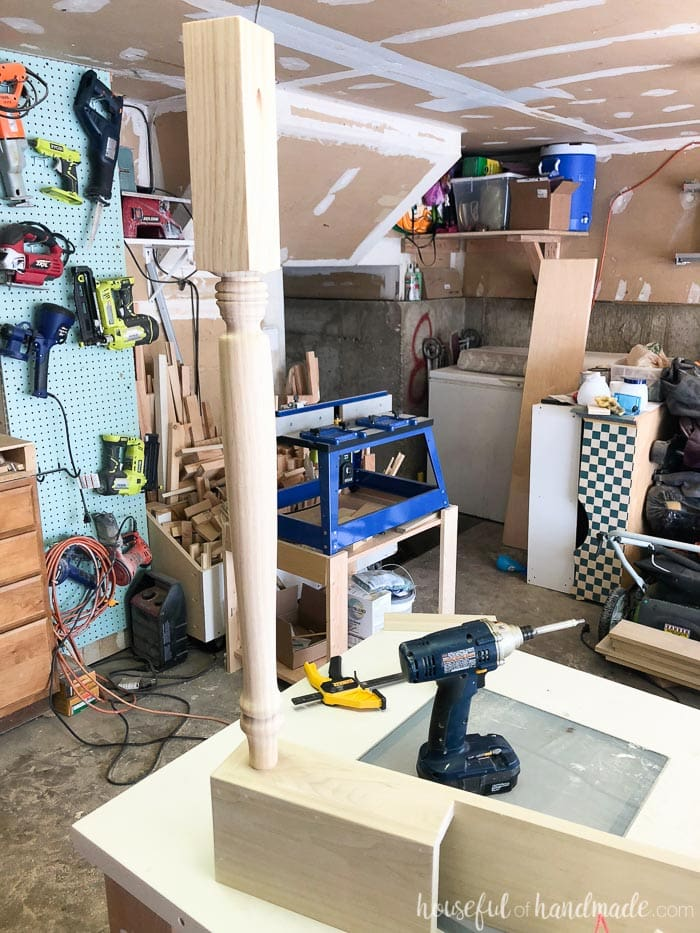 Table leg used to create a farmhouse kitchen island shown with drill.