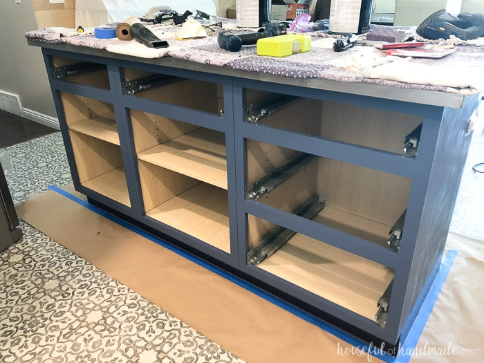 The kitchen island makeover shown with a couple coats of Behr Durango Blue paint.