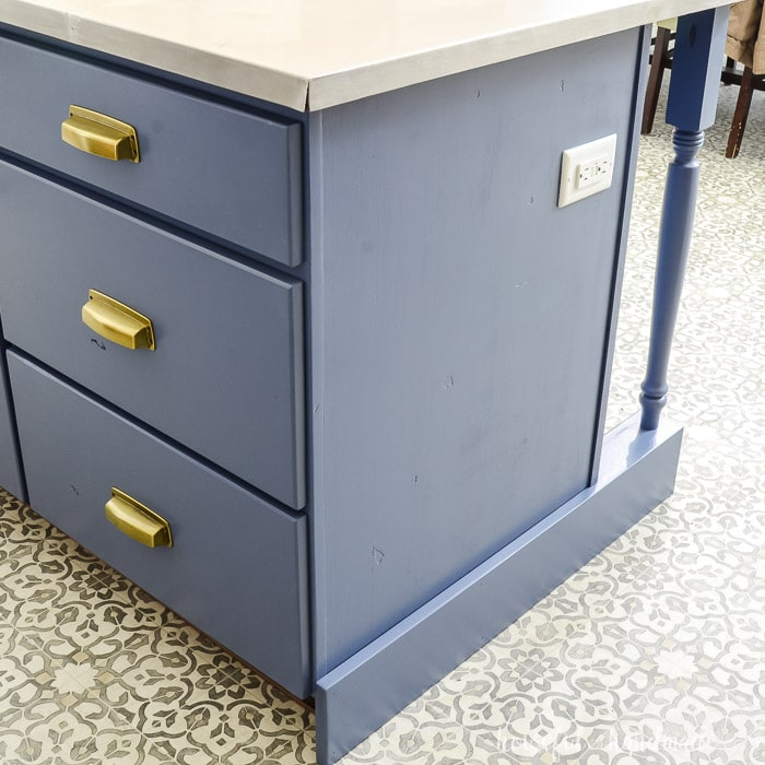 Kitchen island shown painted blue with gold hardware.