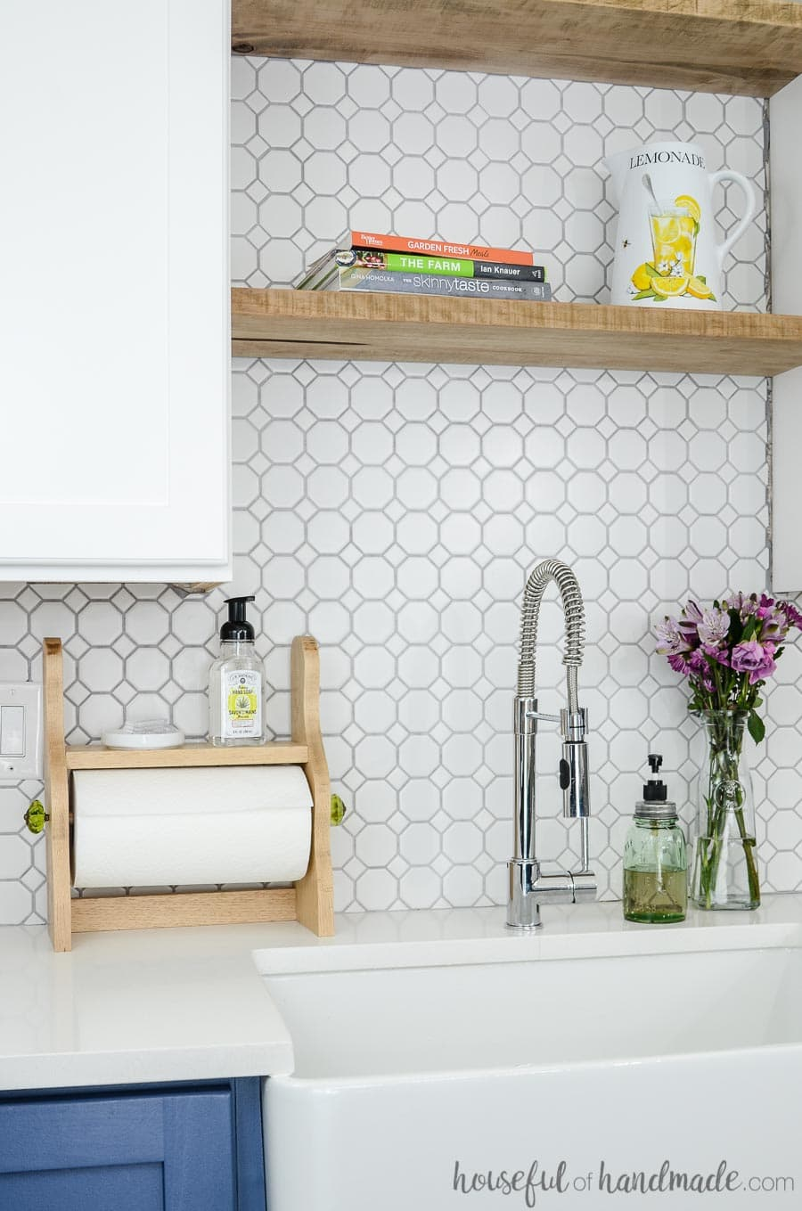 diy farmhouse paper towel holder shown in kitchen next to sink