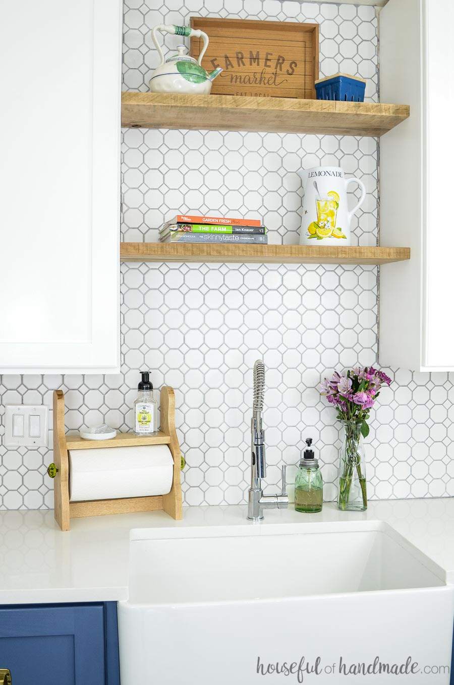 DIY farmhouse paper towel holder shown with farmers market tray on shelves
